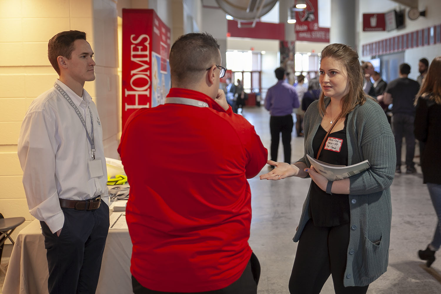 Student talking with recruiters at the annual college job fair in Worthen Arena