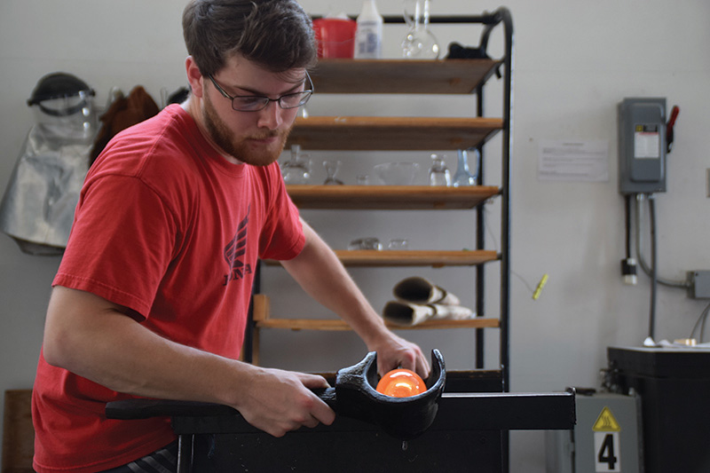 student glass blowing