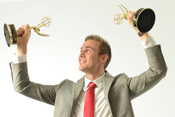 Tyler Bradfield with Emmys
