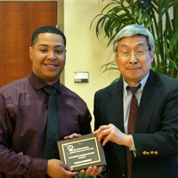 Daryen Scrivener, Outstanding Graduate Student of 2018-2019, with Dr. Taiping Ho
