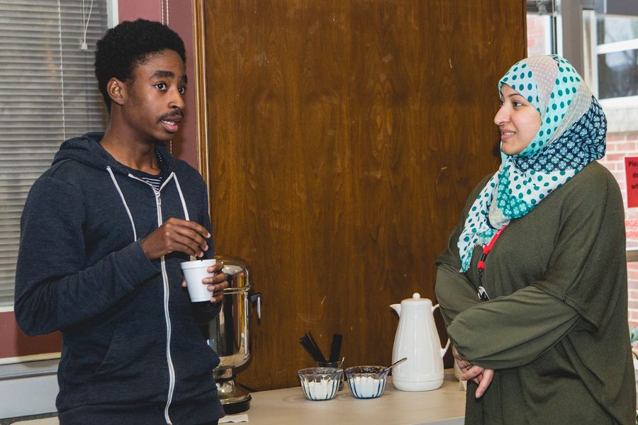 two students talking over coffee