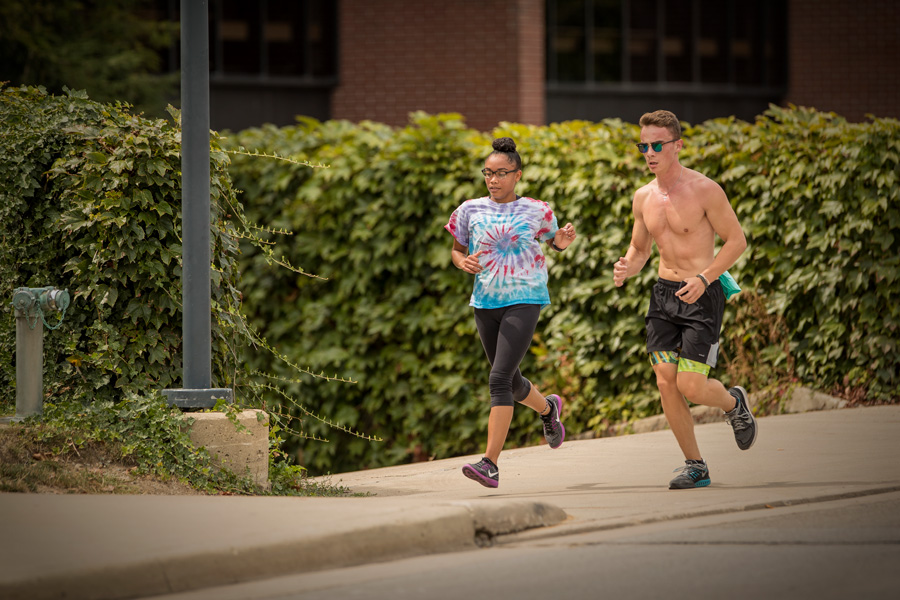students running on campus