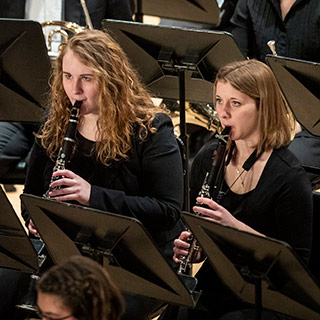 two clarinetists performing